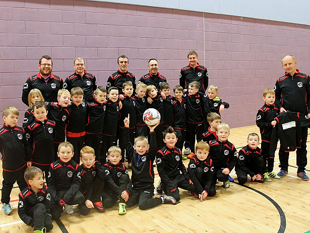 Aberdeen family firm supports local boys' football clubs